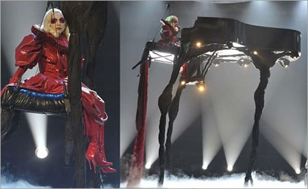 lady gaga tall piano Lady Gaga swings in the air atop a 20 foot tall piano